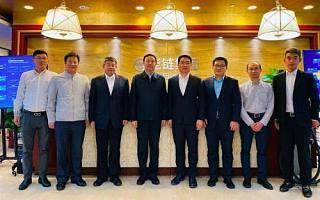 能链集团(车主邦/团油/快电)创始人戴震欢迎大连副市长张志宏一行到访